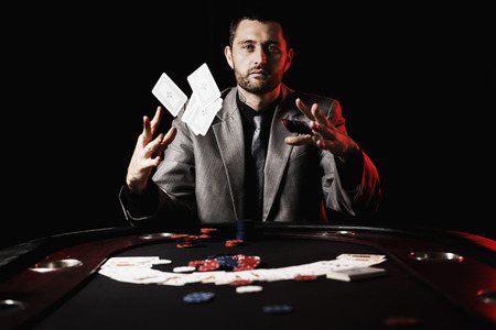 loosing: Concept: A high stakes poker player is frustrated and emotional over loosing and finding it hard to contain his emotions. Cinematic portrait.