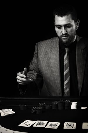 cinematic: Concept: A high stakes poker player is frustrated and emotional over loosing and finding it hard to contain his emotions. Cinematic portrait.