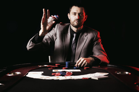 poker chip: Concept: A high stakes poker player is frustrated and emotional over loosing and finding it hard to contain his emotions. Cinematic portrait.