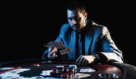 poker player: Concept: A high stakes poker player is frustrated and emotional over loosing and finding it hard to contain his emotions. Cinematic portrait.