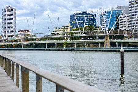 high rises: Brisbane, Australia - Tuesday 23rd June, 2015: View of Kurilpa Bridge and Brisbane City in the daytime from Southbank on Tuesday the 23rd June 2015.