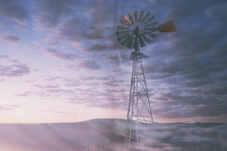 summer heat: Windmill in the outback of Queensland, Australia.
