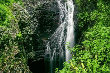 Natural Bridge Waterfall at Springbrook in Queensland. Stock Photo