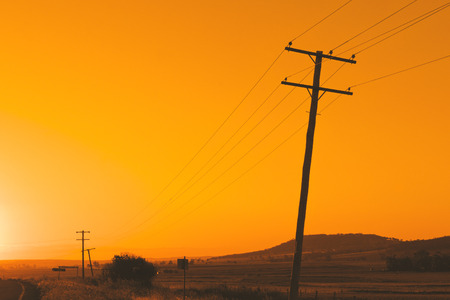 powerline: Timber power line pole with sky in the background during the day in Queensland
