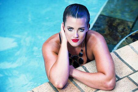 cinematic: Female model posing in bikini outdoors. Cinematic Portrait Style. Stock Photo
