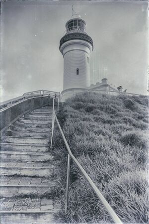 byron: Cape Byron lighthouse in NSW, Australia with added scratches, dust spots and grain to create an aged effect.