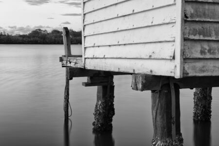 boat house: Maroochy River Boat House in the late afternoon in Maroochydore, Sunshine Coast. Black and White image.