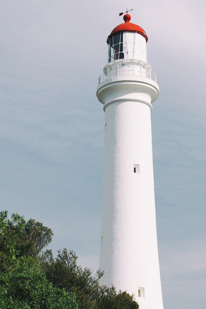 split road: Split Point Lighthouse in Aireys Inlet, Great Ocean Road during the day. Stock Photo