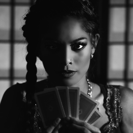 stakes: Concept: A beautiful high stakes poker player is winning big and feeling sensual and confident. Cinematic portrait. Black and white image. Stock Photo