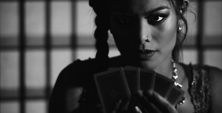 Concept: A beautiful high stakes poker player is winning big and feeling sensual and confident. Cinematic portrait. Black and white image. Stock Photo