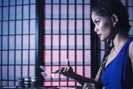 and the stakes: Concept: A beautiful high stakes poker player is winning big and feeling sensual and confident. Cinematic portrait.�