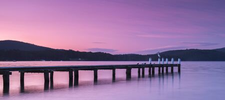 Port Arthur pier at dusk in Tasmania, Australia.