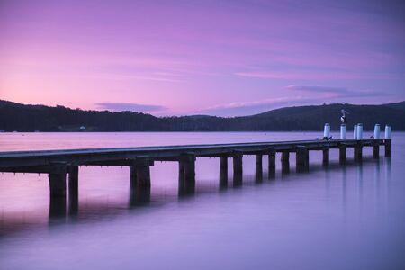 tasmania: Port Arthur pier and hillside at dusk in Tasmania, Australia.