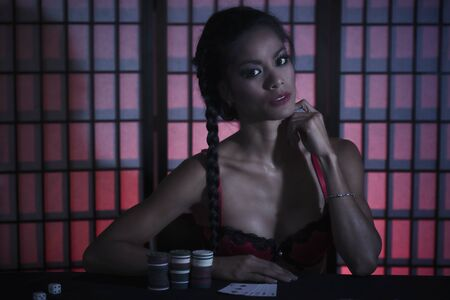Concept: A beautiful high stakes poker player is winning big and feeling sensual and confident. Cinematic portrait.