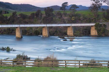 tasmania: Country bridge and river in Tasmania, Australia at dusk. Stock Photo