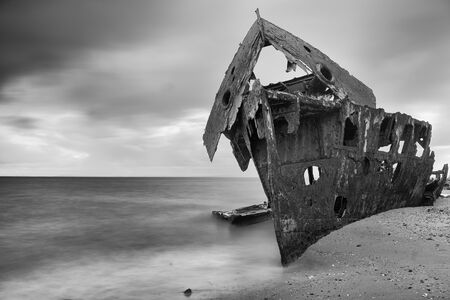 Shipwrecked HMQS Gayundah at Woody Point, QLD, Australia. Black and White.