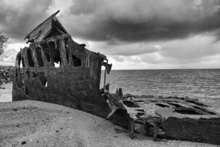 woody bay: Shipwrecked HMQS Gayundah at Woody Point, QLD, Australia. Black and White.