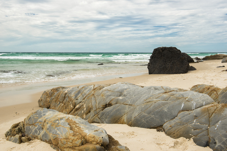 Waves and beach at Snapper Rock, New South Wales during the day. Stock Photo