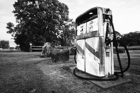 abandoned gas station: Rusted old pump at the front of an abandoned fuel station. Black and White.