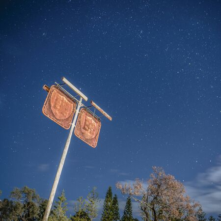 Rusted fuel station sign in the countryside of Brisbane, Queensland.