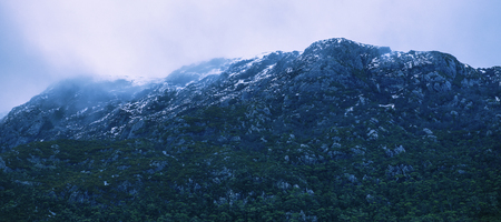 View of a cradle mountain in Tasmania, Australia on a cloudy day.