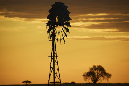 Australian windmill in the countryside of Queensland, Australia. Stock Photo
