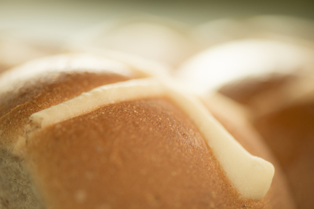 Tasty traditional Easter hot cross buns, closeup view.