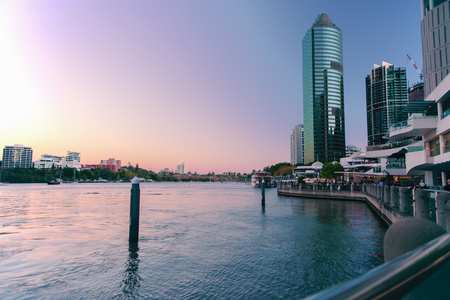 Brisbane, Australia. 19th August 2017 - View of the riverwalk and Eagle Street Pier along the Brisbane River at dusk on 19th August 2017. Editorial