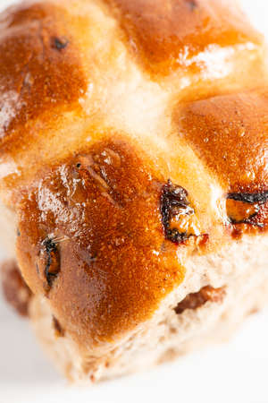 Fresh baked traditional Easter hot cross buns with raisins.