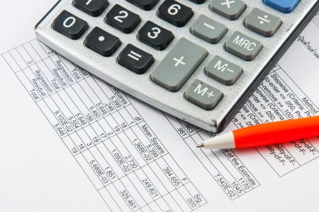 calculators: Calculator and pen  Stock Photo