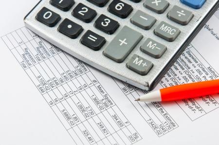 Calculator and pen  Stockfoto