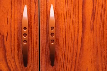 roomy: Old wooden wardrobe doors close up