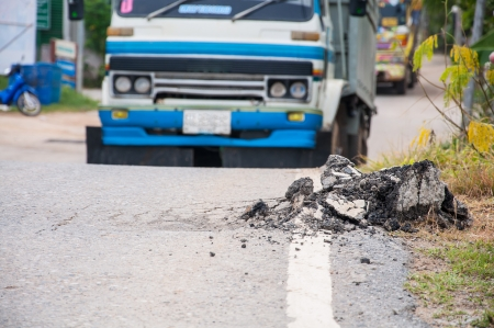 Asphalt surface, the road were demolished due to poor construction.