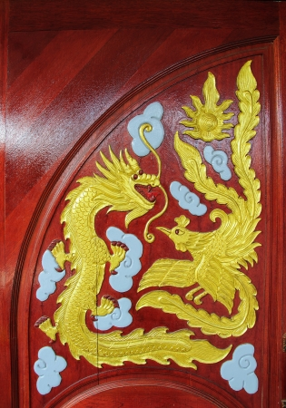 Dragon craft and painting mixed on wood in Chinese temple in Thailand photo