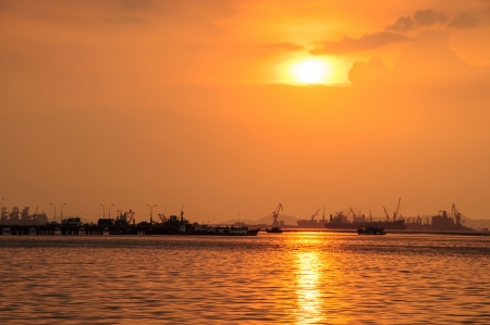 syria peace: Silhouettes of ships arriving in the harbor at sunset