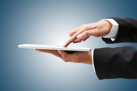 hand of businessman touch tablet, business concept Stock Photo