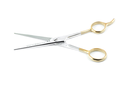 haircutting: haircutting scissors or barber scissors isolated Stock Photo