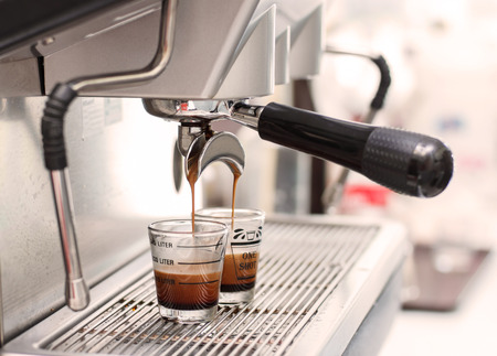 Espresso coffee machine, Coffee is pouring in a glass of coffee machine. photo