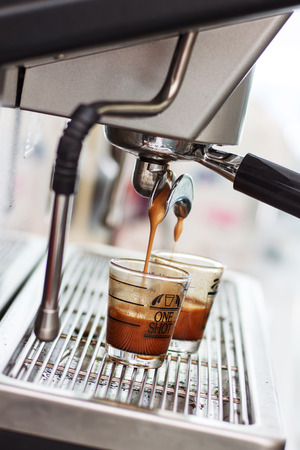 coffee machine: Espresso coffee machine, Coffee is pouring in a glass of coffee machine.