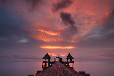 The long bridge over the sea with twilight sky, Thailand. photo