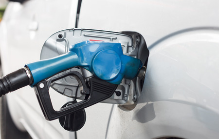 fueling pump: Close up scene of gasoline car refilling Stock Photo