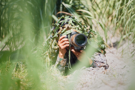 camouflage wildlife photographer. Stock Photo