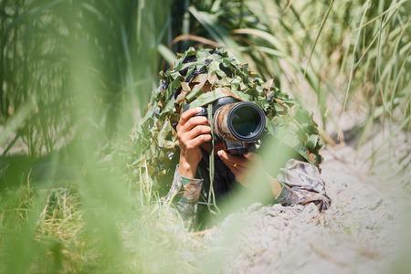 wildlife: camouflage wildlife photographer. Stock Photo