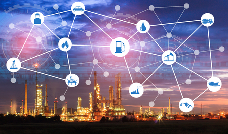 Light oil refinery at twilight with physical system icons diagram on industrial factory. Industry on technology 4.0 concept support with double exposure. Stockfoto