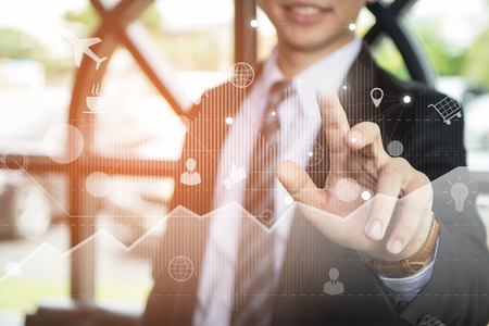 Big data analytics and business intelligence (BI) concept. Businessman Pressing Virtual icons on a digital screen interface background. Technology 4.0 and double exposure.