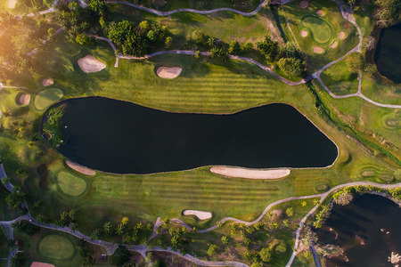 Aerial view photography of forest and golf course with lake. Golf and sport club. Stockfoto