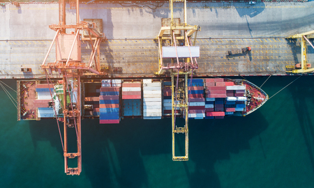 Aerial view sea port Container cargo loading ship in import export business logistic. Freight transportation. shipping business logistic. Trade Port and Shipping cargo to harbor. 免版税图像 - 125215187
