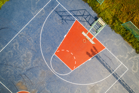 Aerial view, Top View, Bird eye view of school college with Basketball courts. basketball field in morning light.