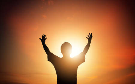 Human hands open palm up worship on sunset