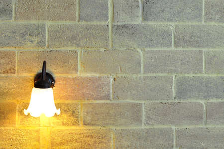 sconce: Lighted classic sconce on the brick wall Stock Photo